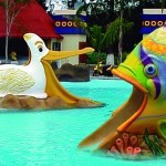 figura resbaladero pelicano y pescado